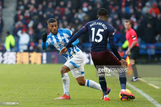 Elias Kachunga of Huddersfield Town looks to block a pass from Ainsley MaitlandNiles of Arsenal during the Premier League match between Huddersfield...