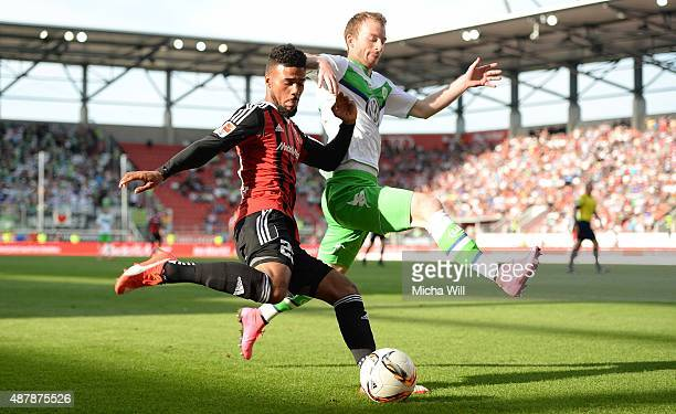 Elias Kachunga of Ingolstadt and Maximilian Arnold of Wolfsburg compete for the ball during the Bundesliga match between FC Ingolstadt and VfL...