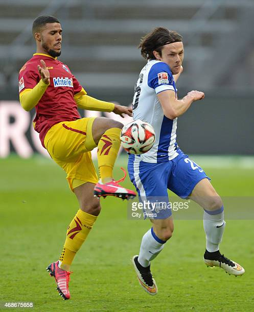 Elias Kachunga of SC Paderborn 07 and Nico Schulz of Hertha BSC fight for the ball during the game between Hertha BSC and SC Paderborn 07 on april 5...