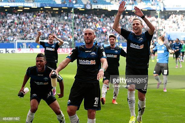 Elias KachungaDaniel Brueckner and Marvin Bakalorz of Paderborn celebrate with the supporters after the Bundesliga match between Hamburger SV and SC...