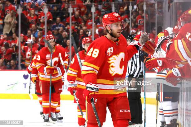 Elias Lindholm and teammates of the Calgary Flames celebrate a goal against the Edmonton Oilers at Scotiabank Saddledome on January 11, 2020 in...