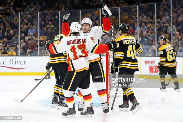 Elias Lindholm celebrates with Johnny Gaudreau of the Calgary Flames after scoring a goal against the Boston Bruins during the second period at TD...