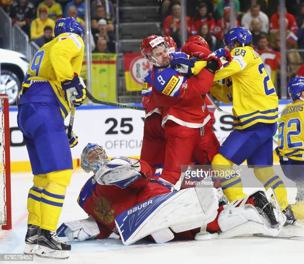 Elias Lindholm of Sweden cand Viktor Antipin of Russia fight during the 2017 IIHF Ice Hockey World Championship game between Sweden and Russia at...
