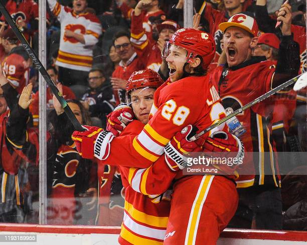Elias Lindholm of the Calgary Flames celebrates after scoring the gamewinning goal against the Edmonton Oilers during an NHL game at Scotiabank...