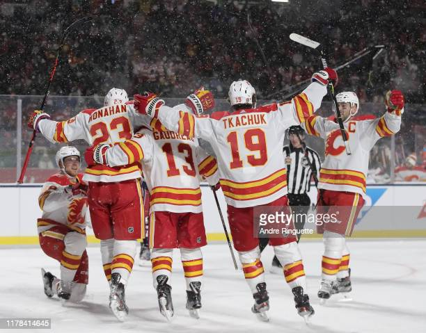 Elias Lindholm of the Calgary Flames celebrates with teammates Sean Monahan, Johnny Gaudreau, Matthew Tkachuk and Mark Giordano after scoring a...