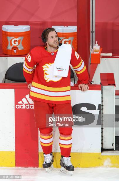 Elias Lindholm of the Calgary Flames does a post-game interview after a win against the Winnipeg Jets at Scotiabank Saddledome on February 9, 2021 in...