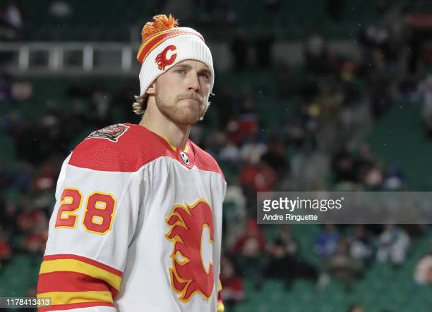 Elias Lindholm of the Calgary Flames walks to the ice for warmup before taking on the Winnipeg Jets during the 2019 Tim Hortons NHL Heritage Classic...