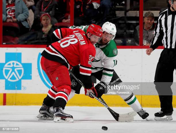 Elias Lindholm of the Carolina Hurricanes wins the face off against Martin Hanzal of the Dallas Stars during an NHL game on November 13 2017 at PNC...