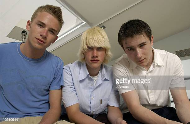 Elias McConnell John Robinson and Alex Frost during 2003 Cannes Film Festival 'Elephant' Portraits at Noga Beach in Cannes France