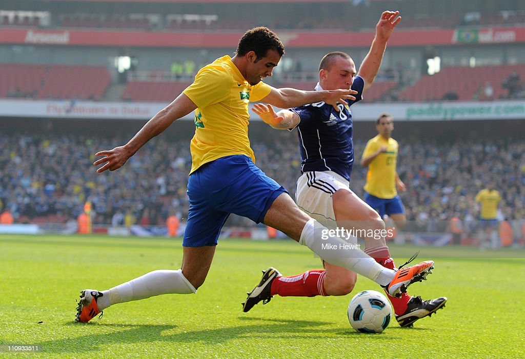Elias of Brazil is challenged by Scott Brown of Scotland during the International friendly match between Brazil and Scotland at Emirates Stadium on March 27, 2011 in London, England.