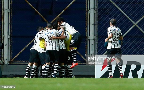 Elias of Corinthians celebrates with his teammates after scoring the first goal of his team during a match between San Lorenzo and Corinthians as...