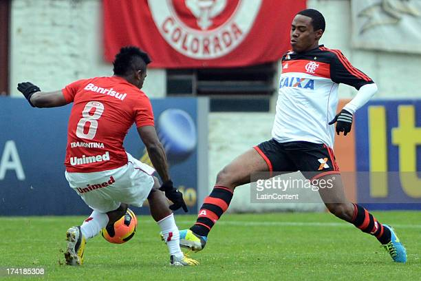 Elias of Flamengo fights for the ball with Willians of Internacional during a match between Flamengo and Internacional as part of the Brazilian Serie...