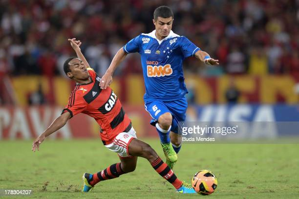 Elias of Flamengo struggles for the ball with Egidio of Cruzeiro during a match between Flamengo and Cruzeiro as part of Brazilian Cup 2013 at...