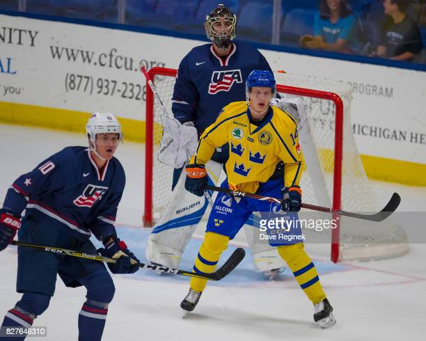 Elias Pettersson of Sweden sets up in front of Keith Petruzzelli of the USA during a World Jr Summer Showcase game at USA Hockey Arena on August 2...