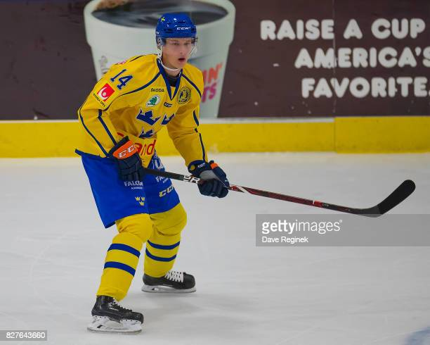 Elias Pettersson of Sweden skates up ice against USA during a World Jr Summer Showcase game at USA Hockey Arena on August 2 2017 in Plymouth Michigan...