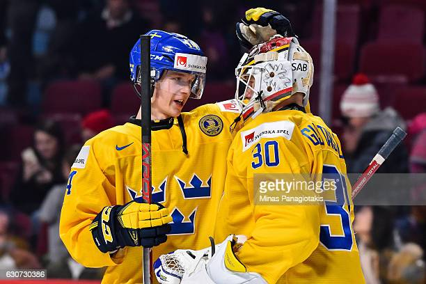 Elias Pettersson of Team Sweden congratulates goaltender Filip Gustavsson for their victory during the 2017 IIHF World Junior Championship...