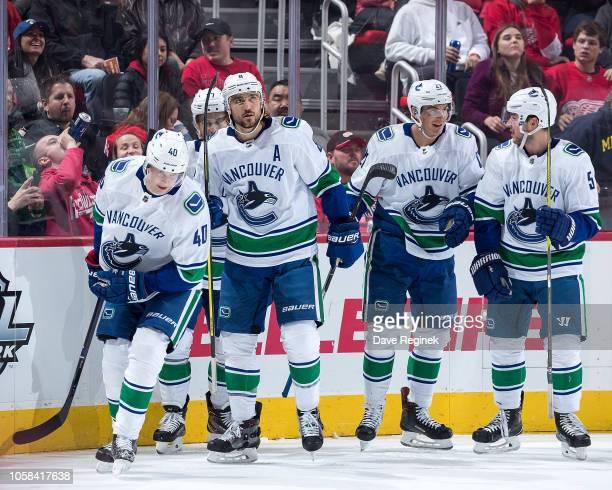 Elias Pettersson of the Vancouver Canucks celebrates his first period goal with teammates Nikolay Goldobin Chris Tanev Ben Hutton and Derrick Pouliot...
