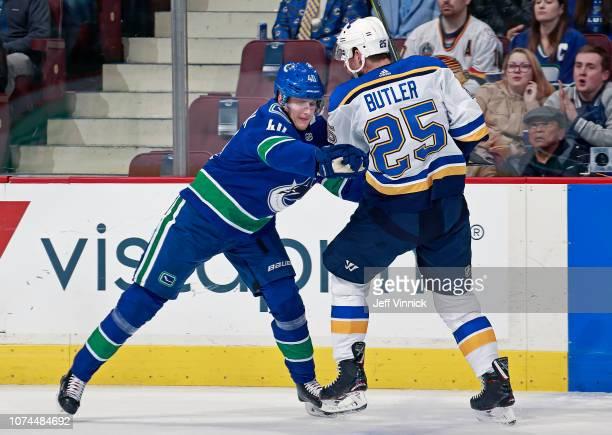 Elias Pettersson of the Vancouver Canucks checks Chris Butler of the St Louis Blues during their NHL game at Rogers Arena December 20 2018 in...