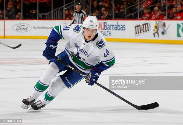 Elias Pettersson of the Vancouver Canucks in action against the New Jersey Devils at Prudential Center on December 31 2018 in Newark New Jersey The...