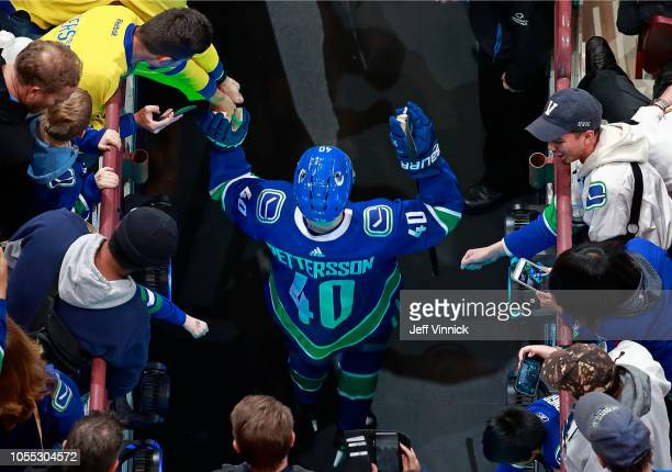 Elias Pettersson of the Vancouver Canucks is cheered on by fans as he walks out to the ice during warmup their NHL game against the Minnesota Wild at...