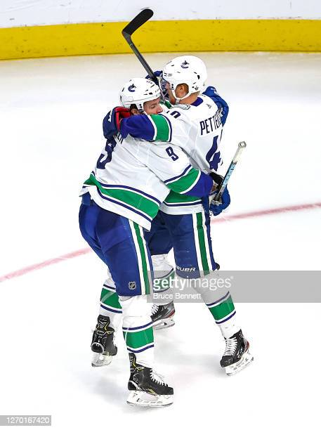 Elias Pettersson of the Vancouver Canucks is congratulated by his teammate, J.T. Miller after scoring a goal against the Vegas Golden Knights during...