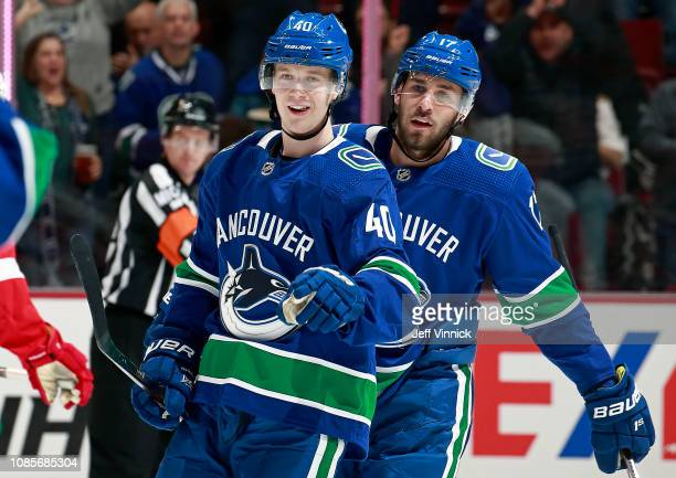 Elias Pettersson of the Vancouver Canucks is congratulated by teammate Josh Leivo after scoring during their NHL game against the Detroit Red Wings...
