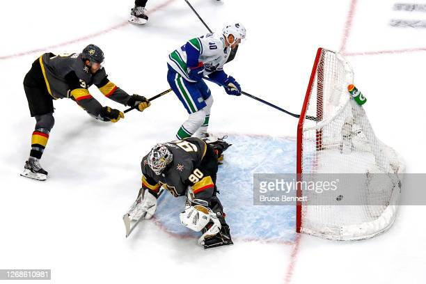 Elias Pettersson of the Vancouver Canucks scores a goal past Robin Lehner of the Vegas Golden Knights during the second period in Game Two of the...