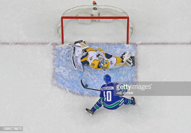Elias Pettersson of the Vancouver Canucks scores on a penalty shot against Pekka Rinne of the Nashville Predators during their NHL game at Rogers...