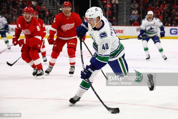 Elias Pettersson of the Vancouver Canucks scores on a shot in the first period while playing the Detroit Red Wings at Little Caesars Arena on...