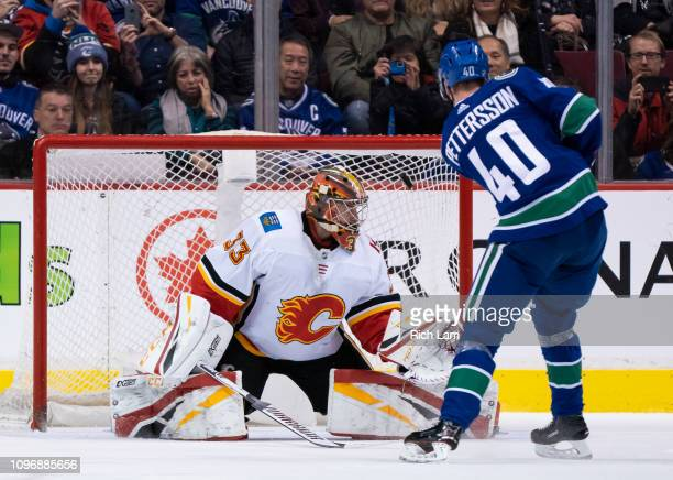 Elias Pettersson of the Vancouver Canucks shoots the puck past goalie David Rittich of the Calgary Flames during the shootout in NHL action on...