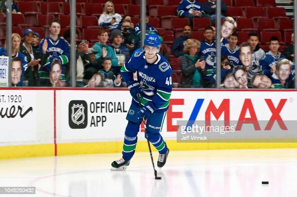 Elias Pettersson of the Vancouver Canucks skates down the ice during warmup before their NHL game against the Calgary Flames at Rogers Arena October...