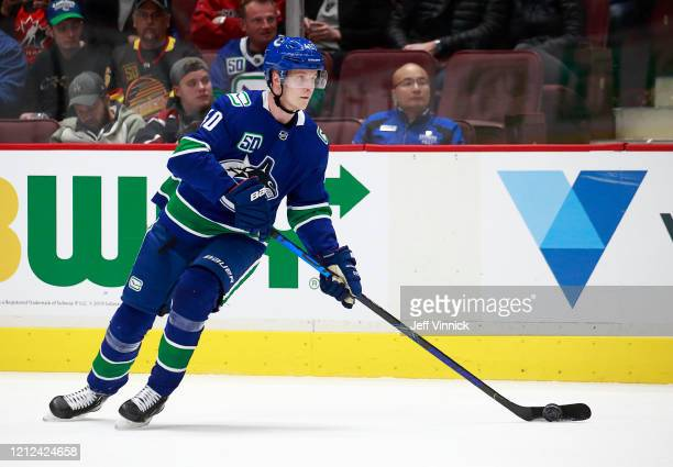 Elias Pettersson of the Vancouver Canucks skates up ice during their NHL game against the Columbus Blue Jackets at Rogers Arena March 8 2020 in...