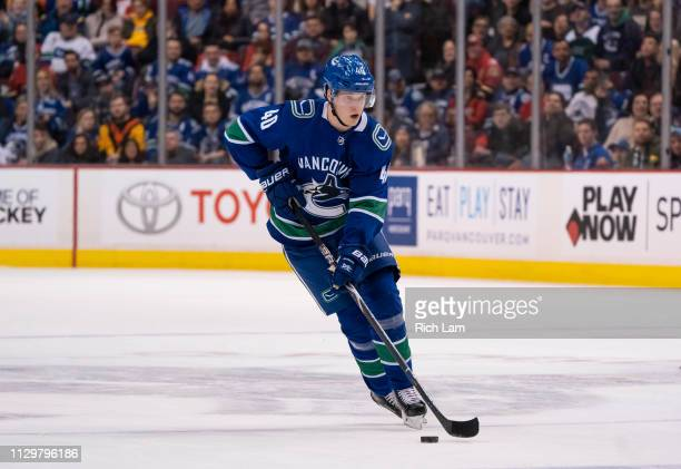 Elias Pettersson of the Vancouver Canucks skates with the puck in NHL action against the Calgary Flames on February 2019 at Rogers Arena in Vancouver...