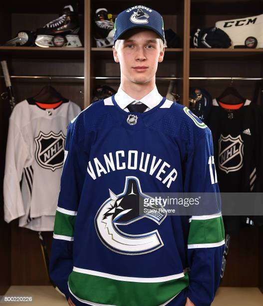 Elias Pettersson poses for a portrait after being selected fifth overall by the Vancouver Canucks during the 2017 NHL Draft at the United Center on...