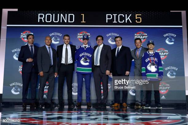 Elias Pettersson poses for photos after being selected fifth overall by the Vancouver Canucks during the 2017 NHL Draft at the United Center on June...