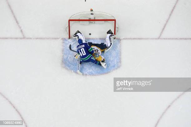 Elias Pettersson scores on a penalty shot against Pekka Rinne of the Nashville Predators during their NHL game at Rogers Arena December 6 2018 in...