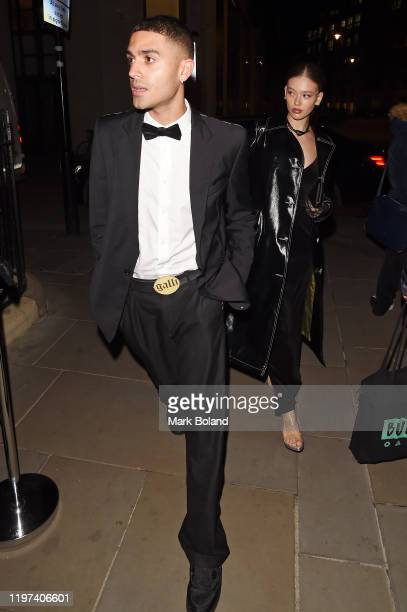 Elias Riadi and Jessica Alexander arrive at the dunhill Dylan Jones PreBAFTA party at dunhill Bourdon House on January 29 2020 in London England