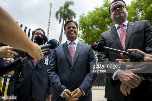 Elias Sanchez, Governor Ricardo Rossello's representative on the federal board, smiles while speaking to members of the media outside the Federal...