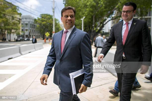Elias Sanchez, Governor Ricardo Rossello's representative on the federal board, left, leaves the Federal Courthouse in San Juan, Puerto Rico, on...