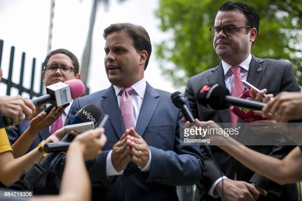 Elias Sanchez, Governor Ricardo Rossello's representative on the federal board, speaks to members of the media outside the Federal Courthouse in San...