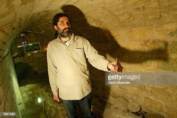 Elias Shama holds a large iron nail, which he believes is the same as those used by the Romans to nail Jesus to the Cross, as he stands in the...
