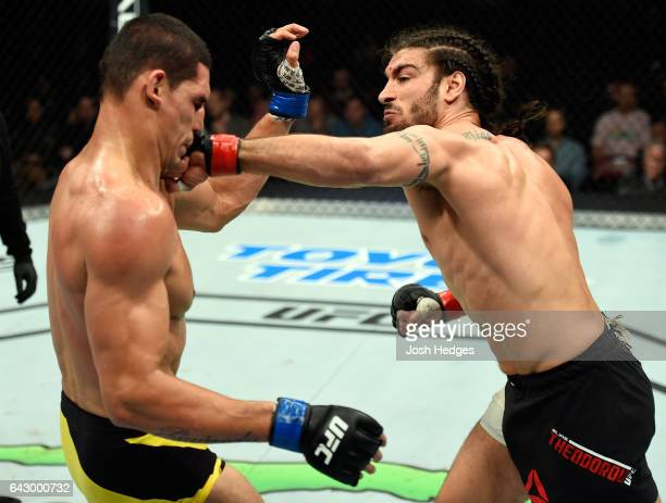 Elias Theodorou of Canada punches Cezar Ferreira of Brazil in their middleweight fight during the UFC Fight Night event inside the Scotiabank Centre...