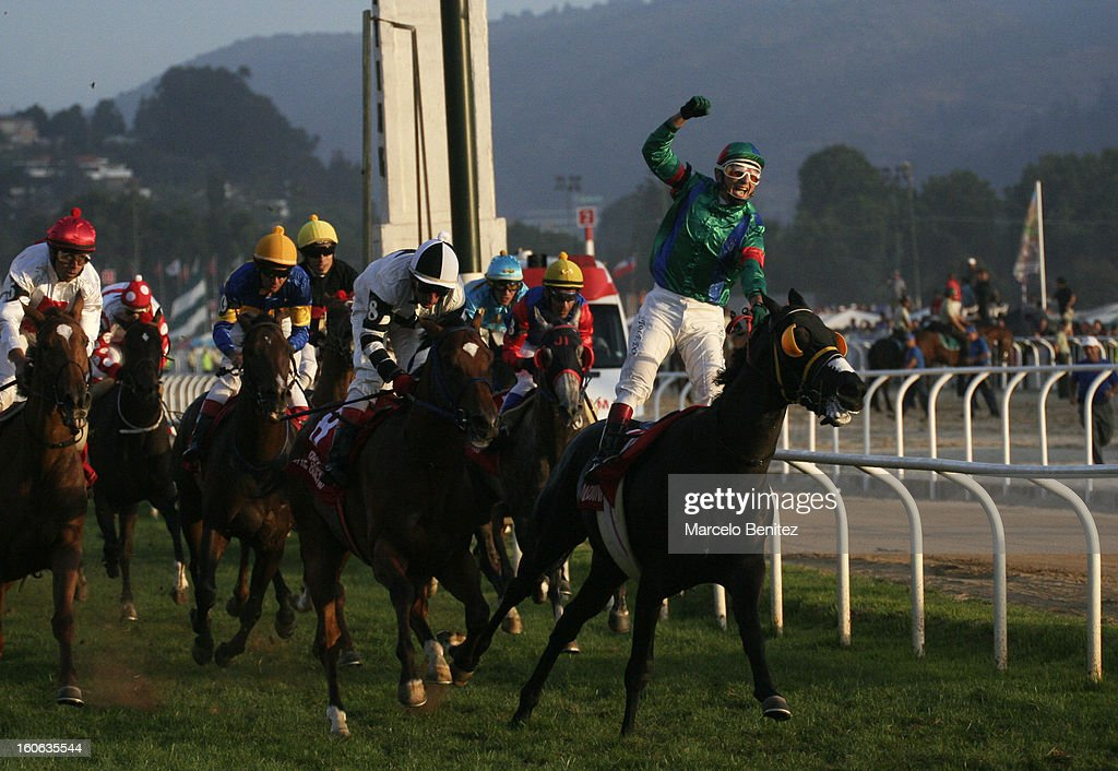 Elias Toledo and his horse Don Dionisio cross the final line of the Derby 2013 on February 03 in Viña del Mar, Chile.