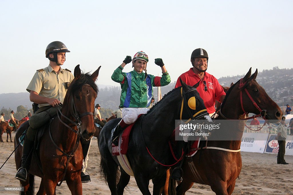 Elias Toledo (C) celebrates winning the race on his horse Don Dionisio in the Derby 2013 on February 03 in Viña del Mar, Chile.