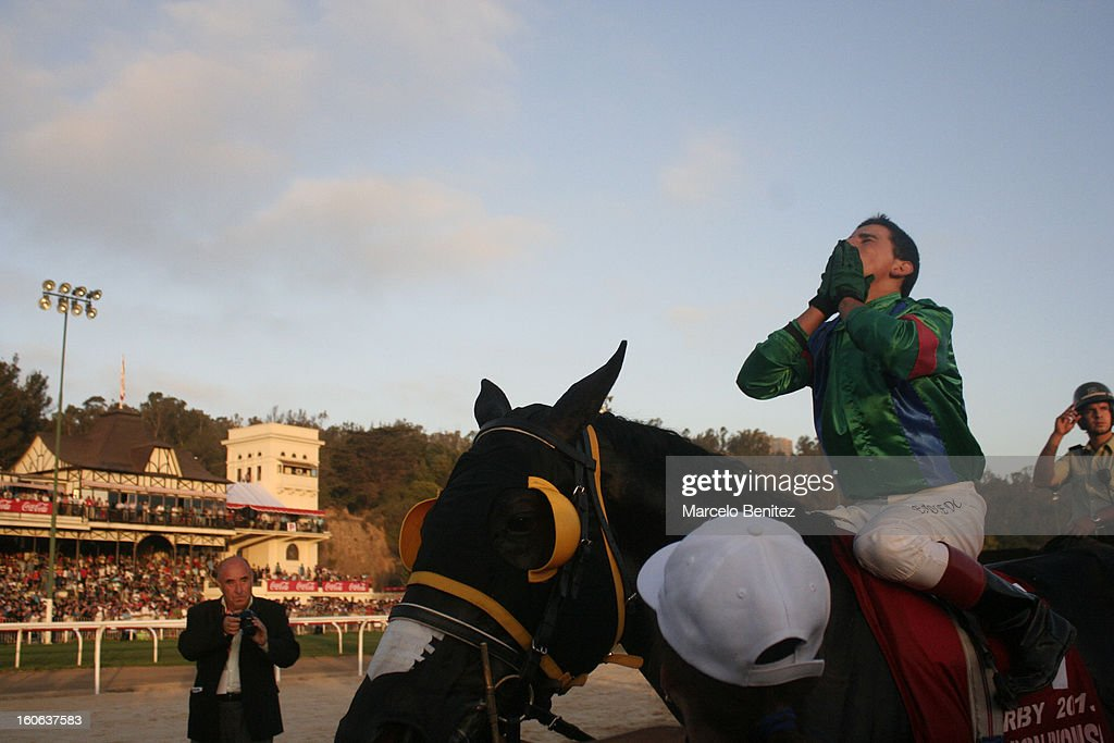 Elias Toledo (C) celebrates winning the race on his horse Don Dionisio after the Derby 2013 on February 03 in Viña del Mar, Chile.