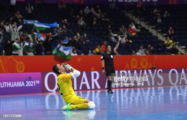 Elibaev Ravshan of Uzbekistan celebrates the goal of Anaskhon Rakhmatov of Uzbekistan during the FIFA Futsal World Cup 2021 group B match between...