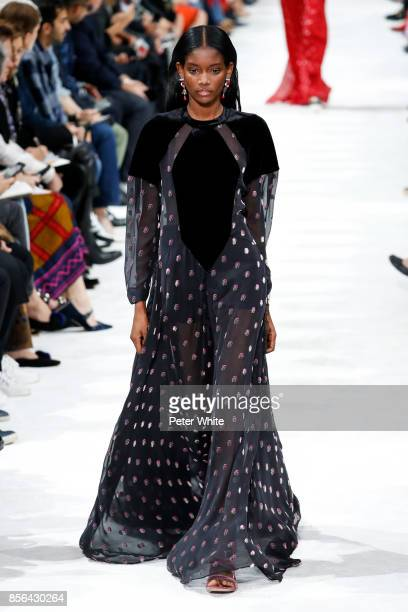 Elibeidy walks the runway during the Valentino show as part of the Paris Fashion Week Womenswear Spring/Summer 2018 on October 1 2017 in Paris France