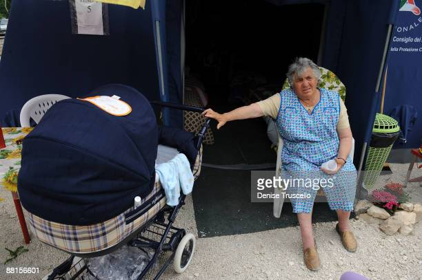 Elide Papola rocks her 7 month old grandson in a tent camp in Onna, the family was displaced after the 6.3 magnitude earthquake struck the Abruzzo...