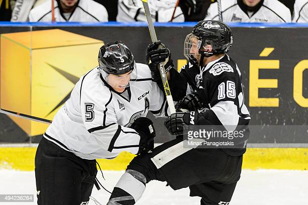 Elie Berube of the Gatineau Olympiques blocks Philippe Sanche of the BlainvilleBoisbriand Armada during the QMJHL game at the Centre d'Excellence...