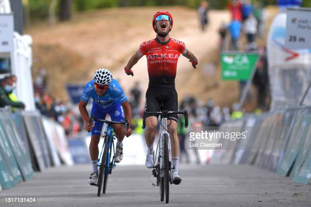 Elie Gesbert of France and Team Arkéa - Samsic stage winner celebrates & João Rodrigues of Portugal and Team W52/Fc Porto blue mountain jersey at...